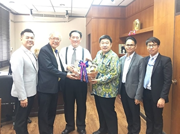 visited Dr. Witoon Simachokdee, Thailand's Minister of Industry, for New Year greetings at the Ministry of Industry on Rama VI Road.