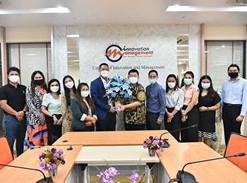Associate Professor Dr. Bundit Phangnirand led a team of personnel to present congratulatory flowers. with Assistant Professor Dr. Pattarawit Yuwattana on the occasion of receiving a new position